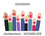 raised up hands volunteering on ... | Shutterstock .eps vector #1023481105