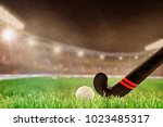 field hockey stick and ball on... | Shutterstock . vector #1023485317