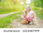 cute little girl having fun... | Shutterstock . vector #1023487999
