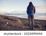 person looking at calafate... | Shutterstock . vector #1023490444