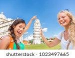 travel tourists friends selfie... | Shutterstock . vector #1023497665