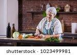 senior woman chopping fresh...   Shutterstock . vector #1023499981