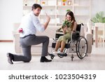 man making marriage proposal to ... | Shutterstock . vector #1023504319