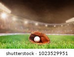 baseball glove and ball on... | Shutterstock . vector #1023529951