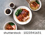 roasted duck on table   asian... | Shutterstock . vector #1023541651