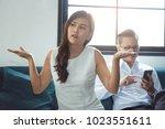 beautiful asian girl feel angry ... | Shutterstock . vector #1023551611