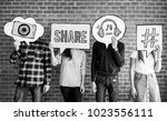 friends holding up thought... | Shutterstock . vector #1023556111