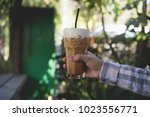 vintage of hand on plaid hold...   Shutterstock . vector #1023556771