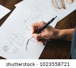 closeup of a calligrapher... | Shutterstock . vector #1023558721