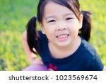 happy little asian girl having...   Shutterstock . vector #1023569674