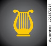 yellow harp icon on black... | Shutterstock .eps vector #1023572314