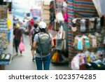 young asian women traveler with ... | Shutterstock . vector #1023574285