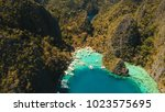 tropical lagoon with azure... | Shutterstock . vector #1023575695