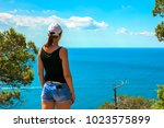 a young tourist girl stands on...   Shutterstock . vector #1023575899