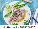 steamed skate wing with caper... | Shutterstock . vector #1023594037