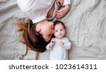 mother and a little child lying ... | Shutterstock . vector #1023614311