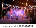 light bokeh of people sitting... | Shutterstock . vector #1023624259