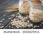 oat flakes or oatmeal cereal in ... | Shutterstock . vector #1023625411