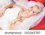 beautiful  bride wearing white... | Shutterstock . vector #102363787