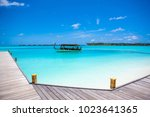 Small photo of Rangali, Maldives island - 14 July 2017: Traditional wooden boat dhoni in the crystal water of the Indian Ocean, Maldives island, 14 July 2017