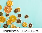 above view on thin citrus chips ... | Shutterstock . vector #1023648025