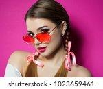 young beautiful playful woman... | Shutterstock . vector #1023659461