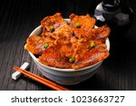 butadon. baked pork covered rice | Shutterstock . vector #1023663727