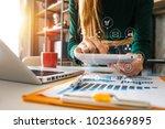 designer woman using smart... | Shutterstock . vector #1023669895