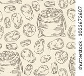 seamless pattern with potatoes... | Shutterstock .eps vector #1023672607