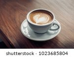 close up hot cappuccino coffee... | Shutterstock . vector #1023685804