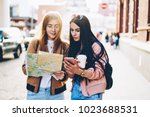 hipster girls in casual outfit... | Shutterstock . vector #1023688531