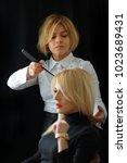 hair salon. woman hairstyle....   Shutterstock . vector #1023689431