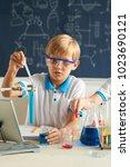 schoolboy in goggles conducting ... | Shutterstock . vector #1023690121