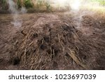 manufacturing charcoal  burn... | Shutterstock . vector #1023697039