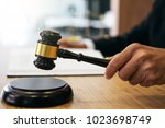 judge gavel with justice... | Shutterstock . vector #1023698749