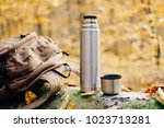 backpack and thermos bottle on... | Shutterstock . vector #1023713281