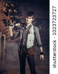 portrait of a young steampunk... | Shutterstock . vector #1023723727