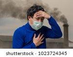 asian man wearing the face mask ... | Shutterstock . vector #1023724345