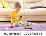 child plays in designer. cute... | Shutterstock . vector #1023733585