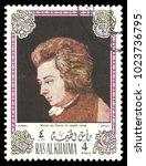 Small photo of Ras Al Khaima - circa 1972: Stamp printed by Ras Al Khaima, Color edition on Art, shows Painting Mozart at the piano by Joseph Lange, circa 1972
