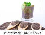 chia seeds on wooden spoon... | Shutterstock . vector #1023747325