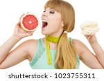 woman with measuring tape holds ... | Shutterstock . vector #1023755311