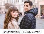 the happy man and a woman... | Shutterstock . vector #1023772954