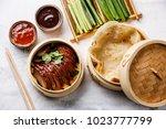 sliced peking duck in bamboo...   Shutterstock . vector #1023777799
