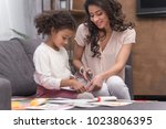 african american mother and... | Shutterstock . vector #1023806395
