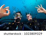 Couple Of Scuba Divers Showing...