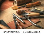 set of leather craft tools on... | Shutterstock . vector #1023823015