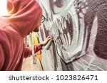 street artist painting colorful ... | Shutterstock . vector #1023826471