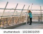 minsk  belarus. young woman...   Shutterstock . vector #1023831055