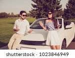 Small photo of Angry partners on journey trip, escape drive ride, guy in formal wear sist on a hood, lady leaning it. Driver and frustrated chic are arguing, fault, guilt, wtf, omg, accuse, cheat, liar concept
